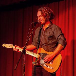Music teacher and Master of Teaching (Primary) graduate Caleb Gorman playing electric guitar.