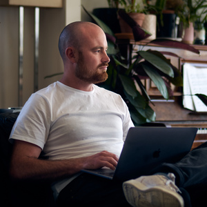 Bachelor of Arts student Harrison Munday studies on his laptop at home